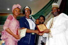 ESOM Principal receiving the Award of Excellence from Alhaji Farouk, Secretary General of Nursing and Midwifery Council of Nigeria