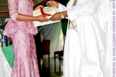 Best Overall Student Olubodun Oluremi receiving her Award from Alhaji Farouk, Secretary General of Nursing and Midwifery Council of Nigeria