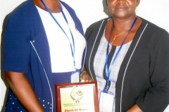 ESOM and ESON Principals Mrs. Dada and Mrs. Maiye with the Award of Excellence for their School